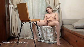 Anolia paints and peels off naked on her chair