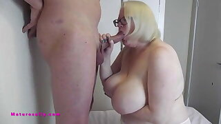 Look at me, huge-chested Sally plays with his cock