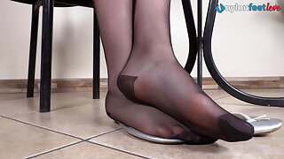 Leggy black-haired under the desk shoeplay wearing pantyhose