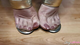 Nylon Feet And Golden Sandals