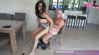 Sexy and busty German milf assistant with glasses and an ugly fellow
