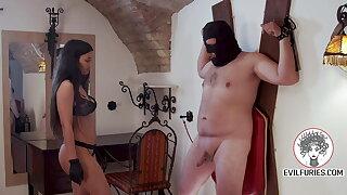 Evil dominatrix destroying manhood
