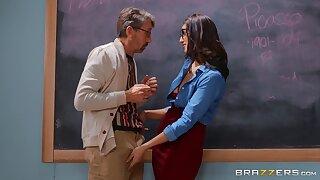 Jiggish brunette Bella Rolland gets fucked in the classroom