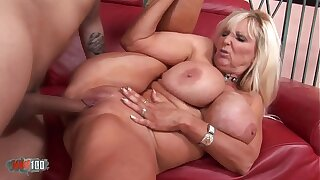 Buxom mature babe banged by a vaillant fucker