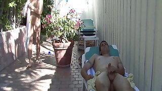 Brunette man sucks his lover in the garden and licks cum