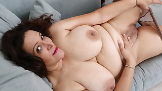 Chunky mature Nicolette takes care of her longing pussy