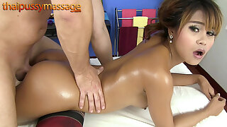 Thai bombshell gets a rub down then gets fucked from behind