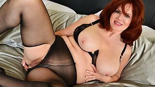 Redhead milf Andi James pleasures her mature labia