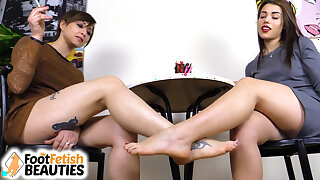 2 mind-blowing barefoot brunettes play footsies under the table
